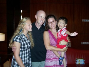 Our 1st picture as a family of 4.  Xander isn't too happy at the moment because he was just handed off too my.