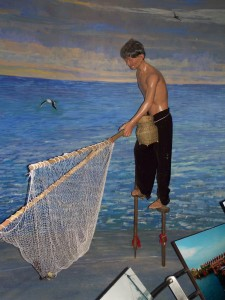 One of the minority groups fish on stilts with nets