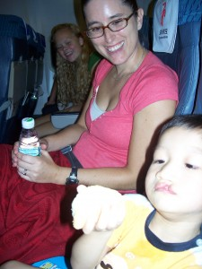 Xander's 1st plane ride eating a roll