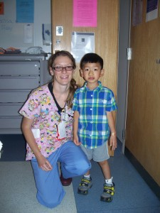 Xander and the awesome nurse he had on Saturday and Sunday.  She really got him up, moving, and feeling better.