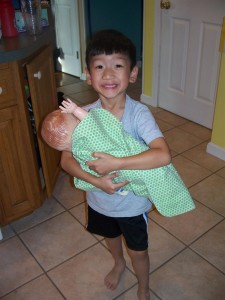 Xander taking care of his baby.